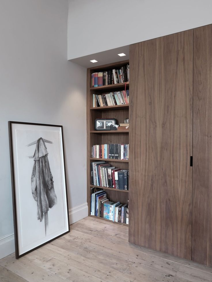 built in shelves, floor to ceiling wooden sliding doors, lights