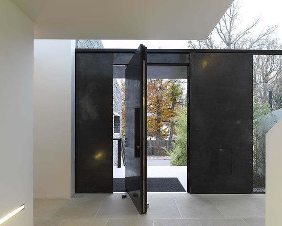 Dark metal with pivot door