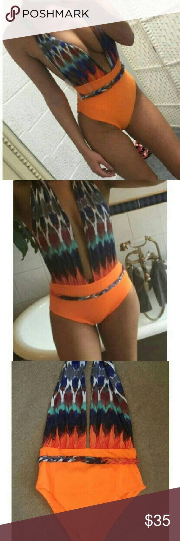 Sexy Orange Multi Colored One Piece Suit Brand New! Sexy Multi Colored orange one piece backless bathing suit. Medium: 33/36B to 33/36C 27/28 waist 35/36 hips. Swim One Pieces