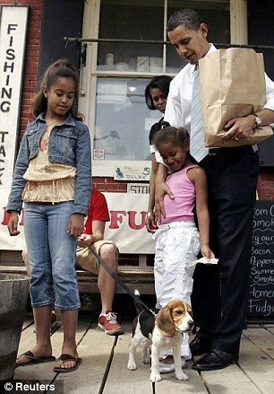 Vacation style: Then senator Barack Obama stands with Malia (left) and Sasha in New Hampshire on May 28, 2007