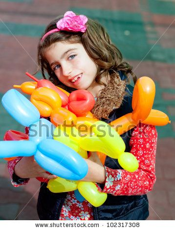 balloon twisting art children happy girl after workshop with many shapes