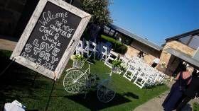 Jodi and Sung's Love story #wedding #ceremony at #Peterson's Champagne House #Pokolbin.  #vintage #country #jademcintoshflowers #whitefoldingchairs #shepherds hooks
