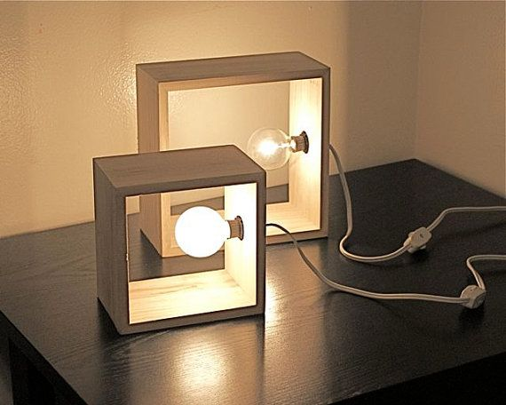 This simple modern wood box lamp can be a wall sconce or a table top accent lamp. Within a wood square box is a candelabra style night light sized