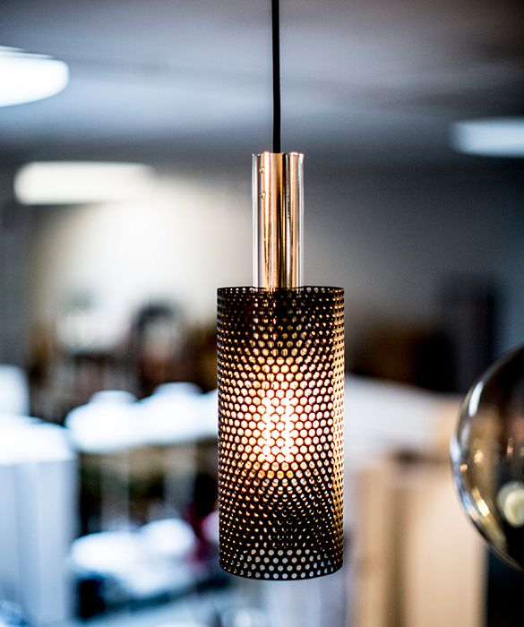 Vouge pendant light by Niclas Hoflin for Rubn. 	All Rubn lights are manufactured by hand with great attention paid to detail, functionality and aesthetics. Their designs respond to contemporary technology, style and needs but are rooted in a very Scandinavian appreciation of the essential quality of materials. 	The Vogue pendant light has a sleek perforated metal shade which is available in white, black or silk grey. The bulb fitting is available in either brass or aluminium. 	Comes with 4m…