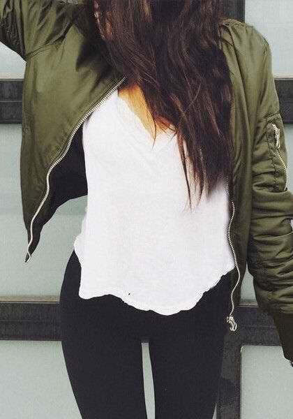 Olive green jacket, white shirt, black jeans