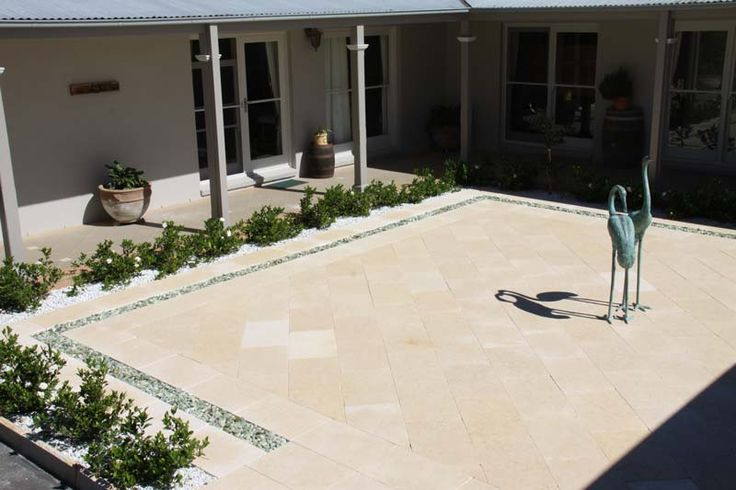 Madagascar Tumbled Limestone Courtyard. Amazing house in Duffys Forest, incredible job by Lone Pine Landscapes, superb pavers from Gaia Stone.