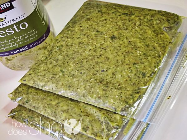 I like to buy my pesto in bulk at Costco in the deli section.  It browns quickly in the refrigerator so I divide it up into little freezer bags.  Then I lay them out flat and freeze.  Whenever I need a bit of flavor I'll break off a little piece.  It is perfect for sandwiches, scrambled eggs, pizza, even to flavor up jarred spaghetti sauce in a pinch.