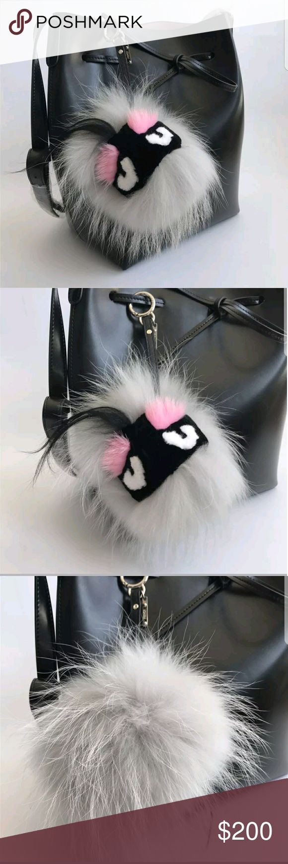 FENDI bag bug FENDI bag bug, she's soft pink and black.  I love her, and you probably will too! I can't do it! I can't sell her, I love her too much. Fendi Bags