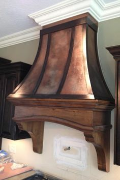 Modern Masters Metal Effects Copper and Bronze paint with both blue and green patina on a wooded range hood then sealed with Permacoat Xtreme | Project by Linda Krukenberg