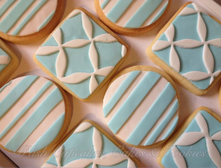 Christening cookies made to match cake.Made by D'lish Cupcakes & Accessories