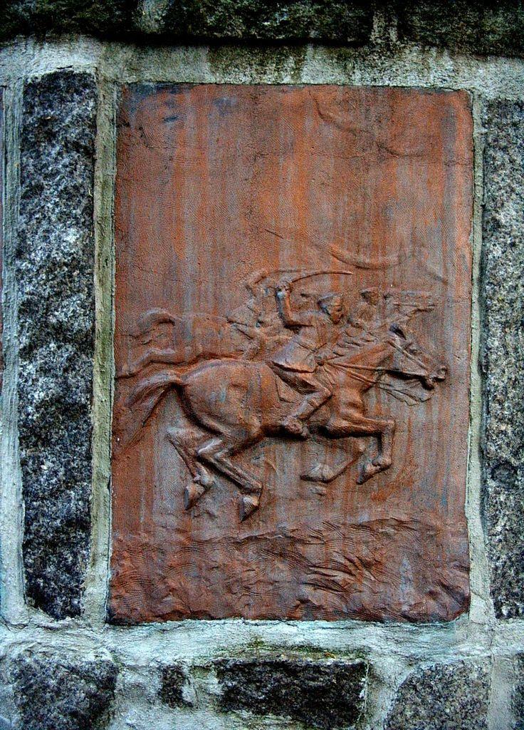 Jedna z płaskorzeźb z Cmentarza Żołnierzy Radzieckich w Wolsztynie