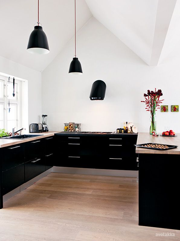 usually into white kitchens, but really into the black and no upper cabinets!  would probably do open shelves for additional storage & opportunity to add pops of color!