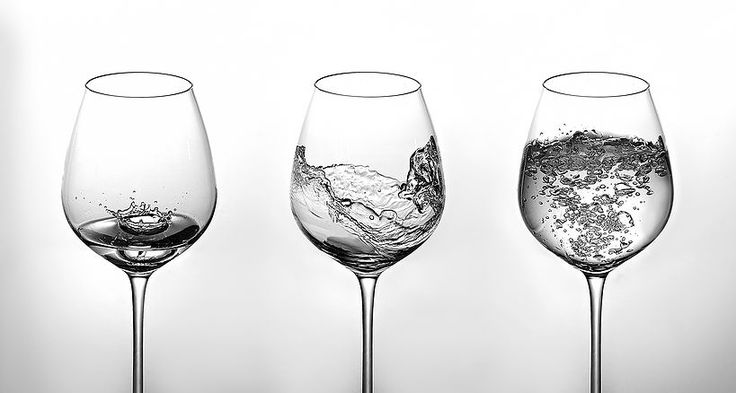 Creative product photography with water splashes in glasses.