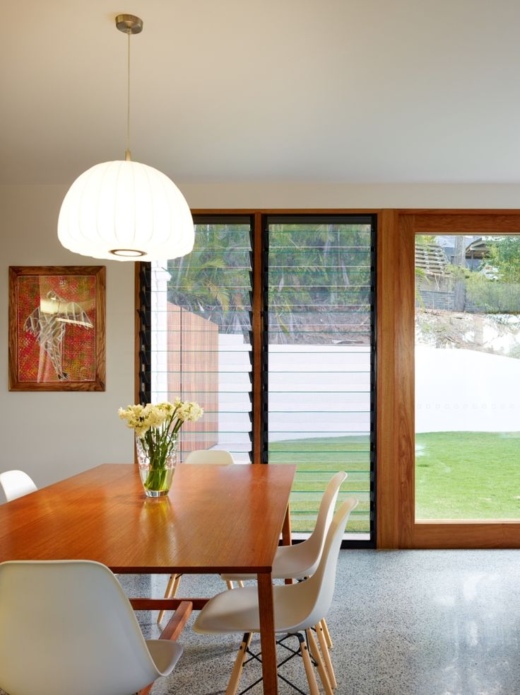 Living room with Breezway Louvre Windows next to sliding timber door