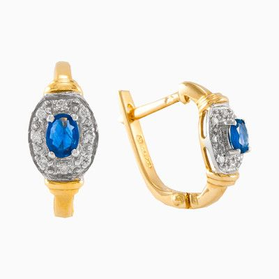 Sapphire gold earrings with halo diamonds with a total weight 0.08 ct. Each earring has an oval, light-blue natural sapphire with a total weight 0.42 carats. Is made entirely by hand in 18k yellow gold, earrings are very practical and suitable for everyday wear.