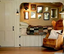 Cozy bed & chair, mirrors on the wall to catch light from the windows opposite -- but I would not enjoy making that bed.