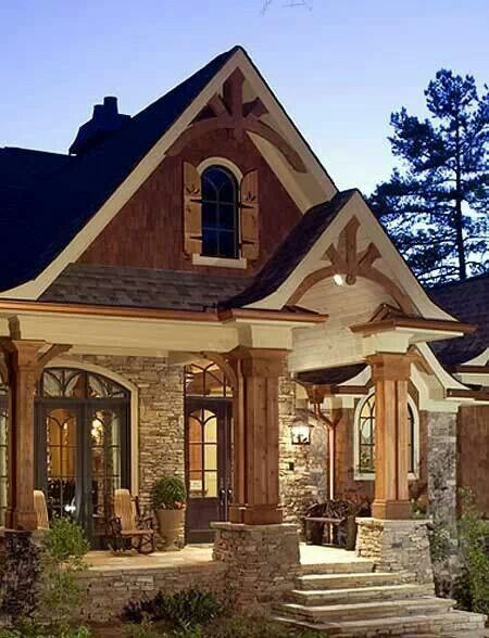 Absolutely love the stone porch and trusses, this entry way is GORGEOUS!!