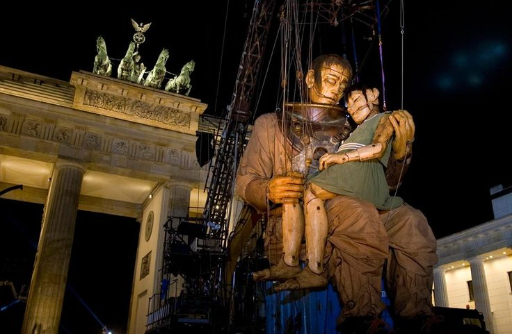The Big Giant and Little Giantess, after having finally reunited, rest together in front of Brandenburg Gate in Berlin, Germany, on October 3, 2009, in honor of German Unification Day.