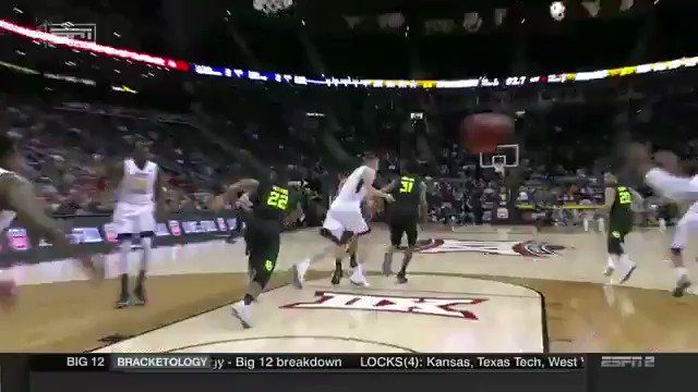 Jevon Carter's half court shot at the end of first half against Baylor University in Big 12 Tournament play 2018.