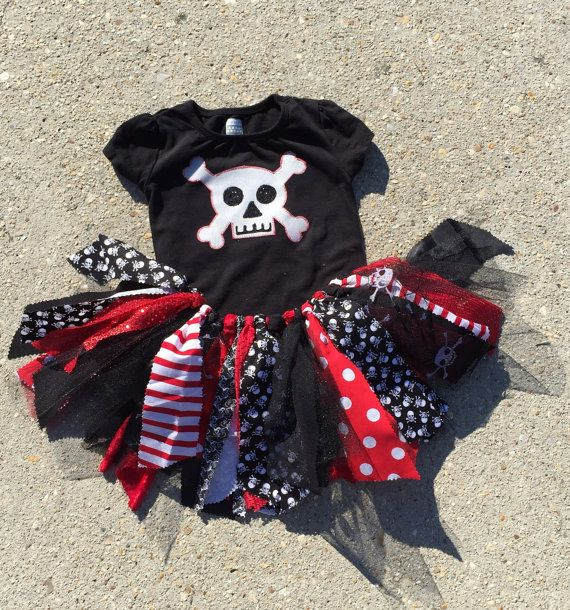This fun pirate costume will be a hit for any pirate birthday or event! This outfit includes a pretty fabric and tulle tutu in red, black and skull