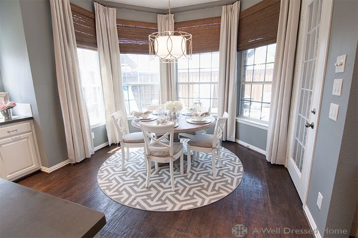 pedestal table on round rug, window treatment style
