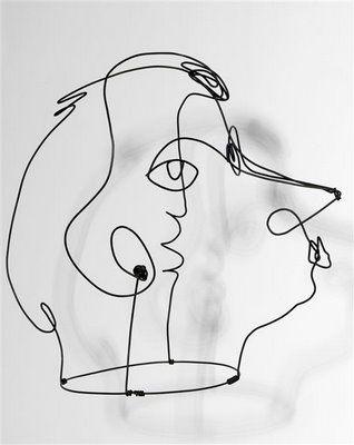 Alexander Calder modelling Kiki de Montparnasse, 1929