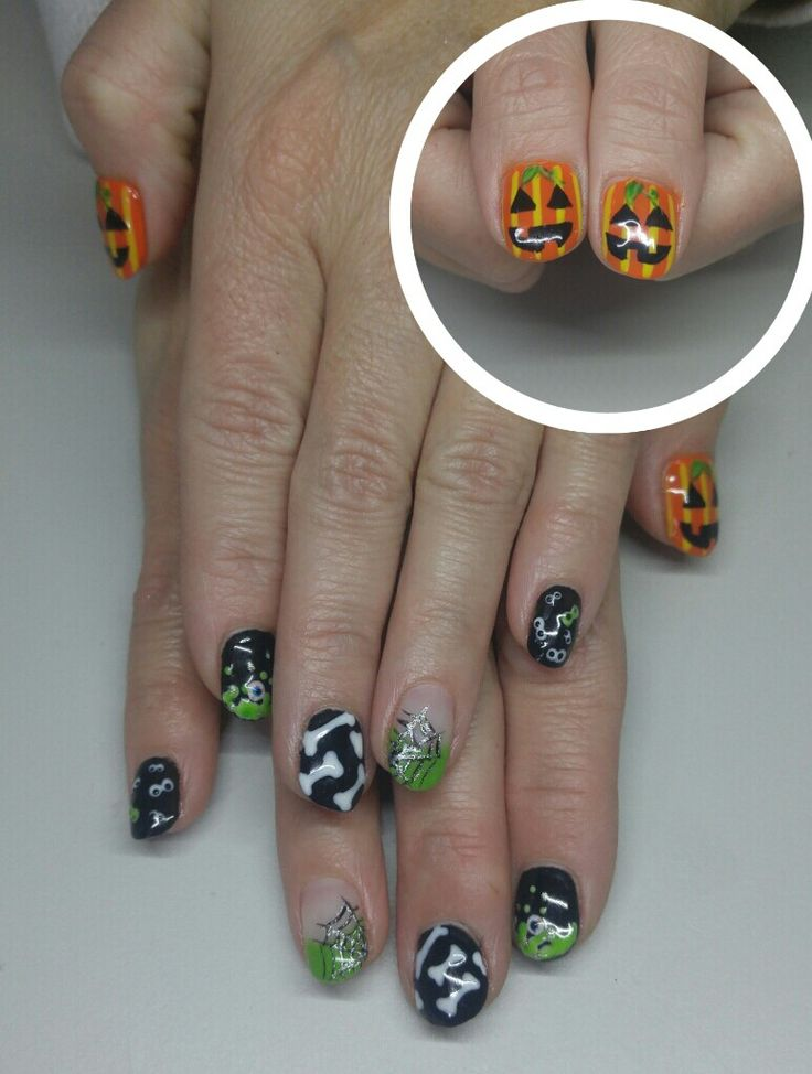 All hand painted halloween nail art. Love how different each nail is but they come together well
