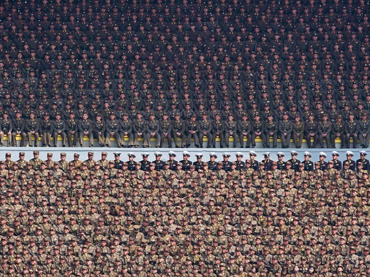 No, not a photo by Andreas Gursky. Just North Korean soldiers attending an official ceremony at the Kim Il-Sung stadium in Pyongyang.