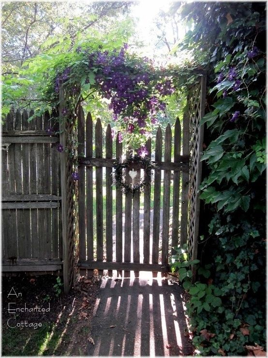 ♥ Love this gate, with the heart that is created when gate is closed...and beautiful clematis blooms draping down (1) From: An Enchanted Cottage, please visit
