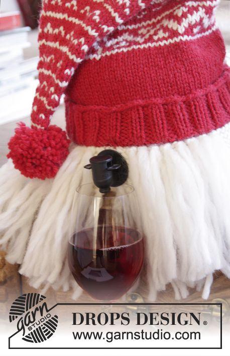 Merrier Christmas - DROPS Jõulud: DROPS Nepal lõngast kootud päkapiku müts - veinipaki kate, Eskimo lõngast habemega - Free pattern by DROPS Design