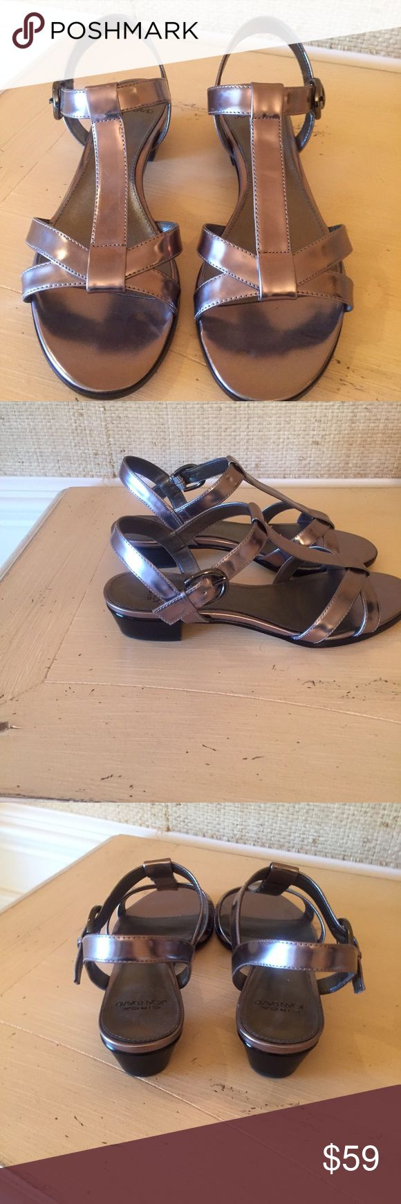 Joan & David NWT leather silver sandal. Size 6 Pretty never worn sandal. Silver with a small heel. Joan & David Shoes Sandals