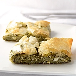 Greek Spanakopita - Flaky phyllo pie stuffed with with spinach and feta cheese, seasoned with dill.