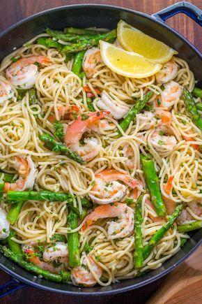 Shrimp Scampi Pasta with Asparagus has a lemon garlic and herb sauce that packs so much fresh and amazing flavor. A 30 minute shrimp scampi pasta recipe!   natashaskitchen.com