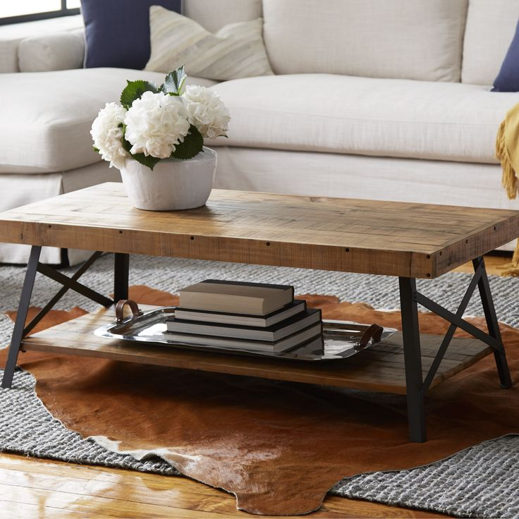 Artfully crafted of reclaimed Asian hardwood and metal, this rustic coffee  table showcases a planked top and open bottom shelf. The collection is sure  to ...