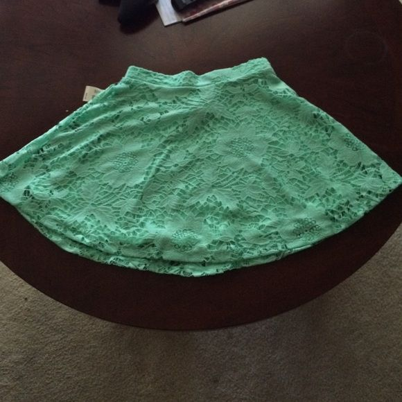 The perfect teal skirt (NWT!!)  Available in medium and XS.  Sassy Skirt Stretch waist teal lace skirt. Under layer is a silky fabric and the over layer is the lace flower pattern. Very cute! Color is gorgeous! Bright and vibrant!  ! Never worn! Too small for me  usually don't buy from here but love this skirt. Had to buy another one that fit and wear it all the time  Aeropostale Skirts