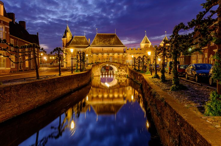 https://flic.kr/p/GBV466   Koppelpoort at blue hour   View at the back of the Koppelpoort in Amersfoort, Utrecht, The Netherlands.  Fuji X-E2 + Fujinon 10-24mm at 18mm, f/8, 13 sec. exposure at ISO 200.  Thanks to everyone who takes the time to comment and/or fave.  © Koos de Wit All rights reserved. Please don't use this image without my permission. www.koosdewit.nl