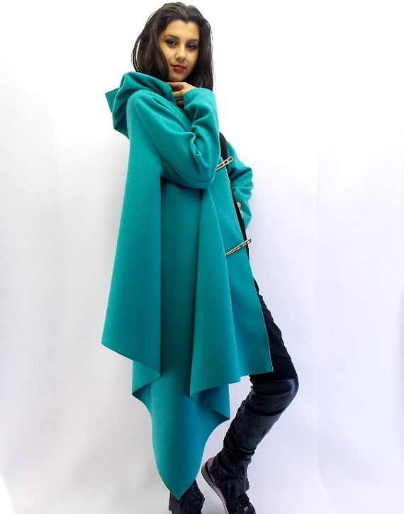 Plus size coat. Asymmetrical extravagant jacket, with asymmetrical metal closure. Hoodie cape. No lining. Material: 30% wool, 70% polyester Care
