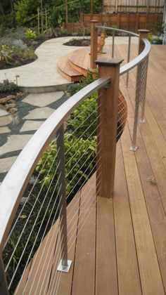 Very cool curved deck railing with metal top rail and cables supported by wooden posts steps for Curved metal railings exterior