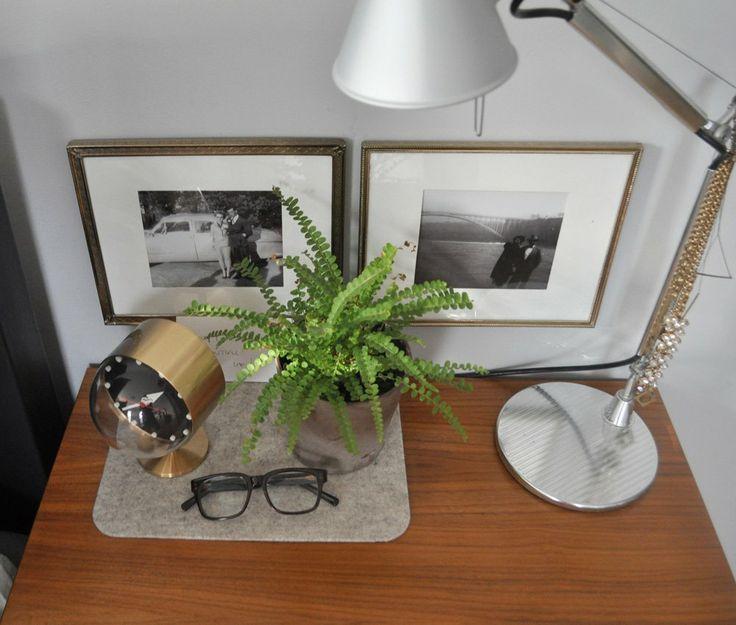 Framed photos behind bedstand -- Bryan & Sarah's Vintage Modern Home & Studio