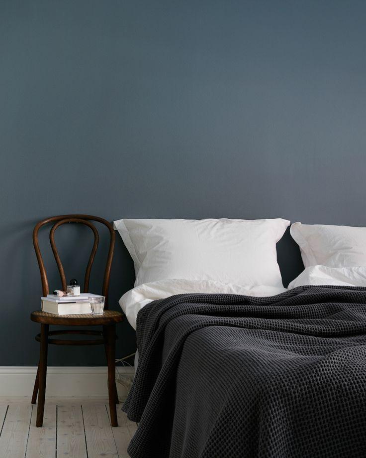 simple bedroom design, dark blue wall and warm brown wood