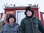 Life Below Zero Chip and Agnes Hailstone outside their home in Noorvik, Alaska, a few others on the show