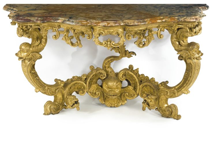 A pair of important Italian Rococo carved giltwood console tables. Sicily or…