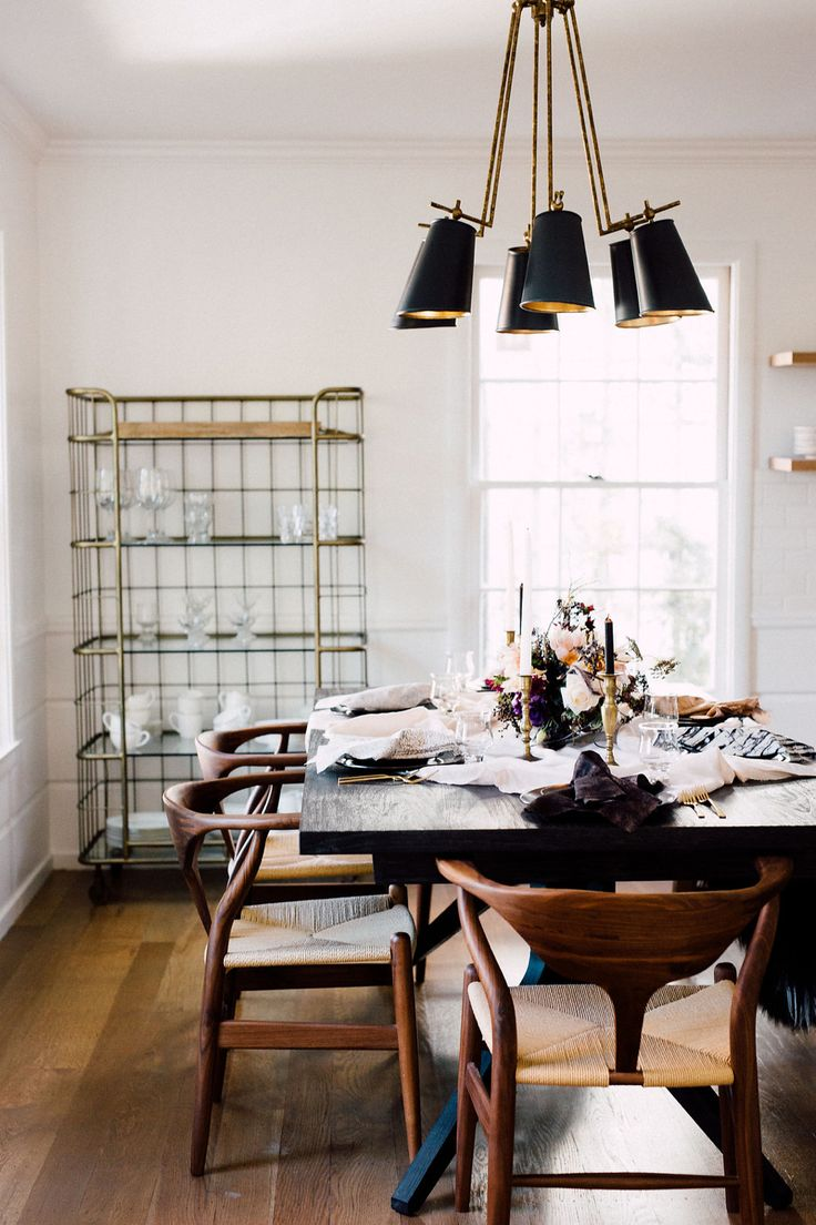 Amazing black midcentury modern light fixture in dining eoom