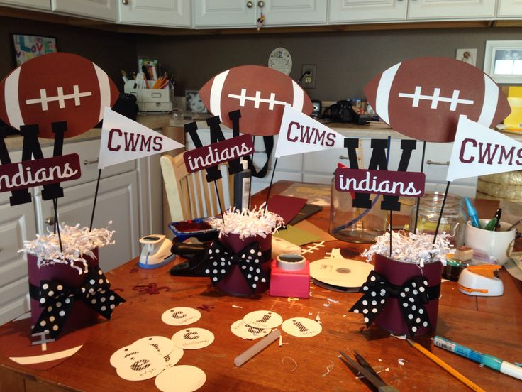 Football/basketball cheer/cheerleading decorations, centerpieces.  Awards, banquet or dinner.  Used soup cans covered in cardstock as base.