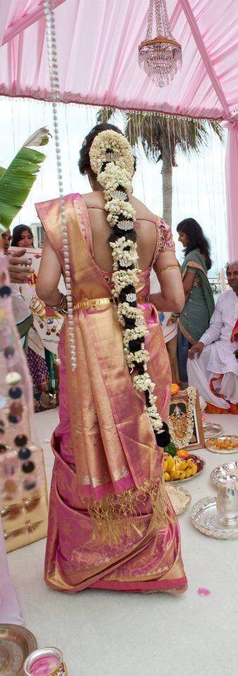 Madras wedding hairstlye long jadai with fresh jasmine flower decoration and diamond studded lotus hair jewellery pink and gold elegant