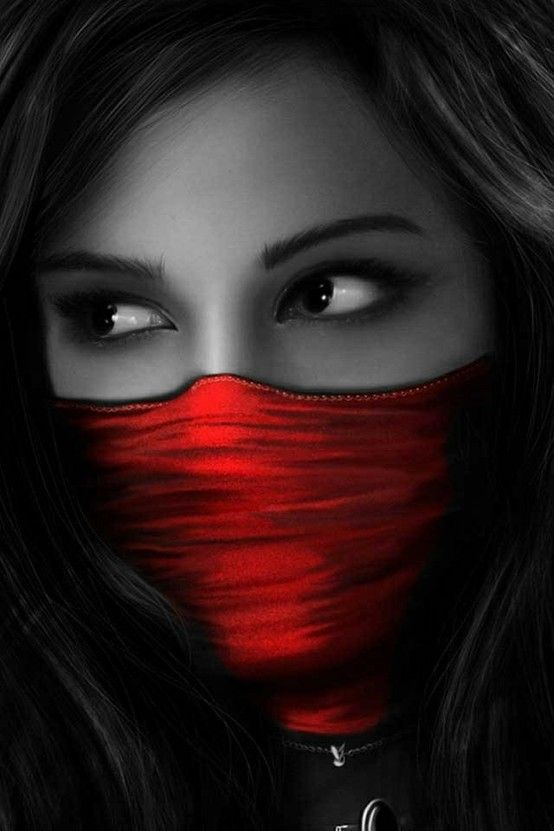 Love this - the contrast of the red mask with the black ...