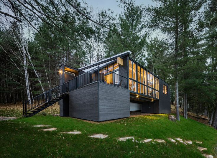 Set on a remote lake in Quebec, this prefab cabin was constructed entirely of cross-laminated timber (CLT), a durable material made from black spruce.
