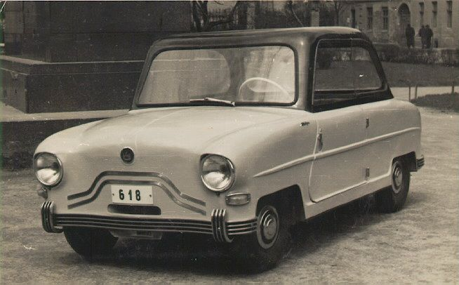 Hungarian microcar the 2+2 seater Alba Regia. It had an aluminum body, airplane tail wheels, and was powered by a Pannonia 250 cc motorbike engine.