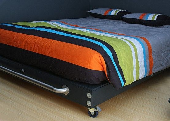 I like how it has wheels on it!  DIY bed frame by lydia