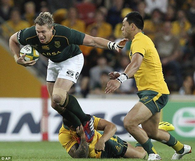 Strength: Jean de Villiers (left) of South Africaleaps past Christian Leali'ifano (right) of Australia